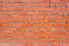 Wall of red brick with fluted texture Stock Photos