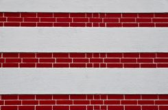 Wall with red-brick layer. Outside wall with red-brick layer and white concrete Stock Images