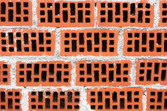Wall of red bricks with cement Stock Images
