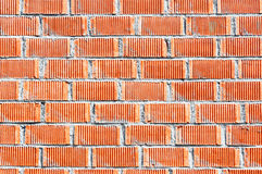 Wall of red bricks with cement Stock Photo