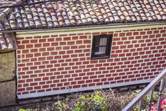 Wall of red bricks on a house. royalty free stock photography