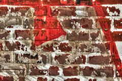 Wall with paint rests for abstract background. Wall of red bricks with rest of white color for abstract background Royalty Free Stock Image