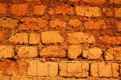 Wall of red earth bricks Royalty Free Stock Photos