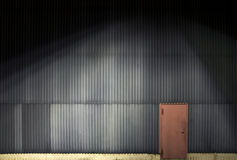 Wall with red metal door Royalty Free Stock Photography