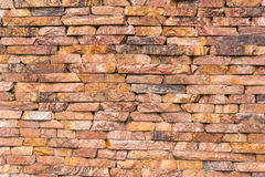 Wall of red stone tiles Stock Photo