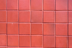 A wall of red tile aging by time and faded by wheather. A fine work and background for house design. Indoor and outdoor royalty free stock images