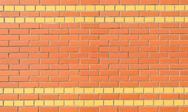 The wall of red and yellow brick Royalty Free Stock Images