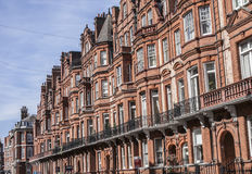 A wall of redbricked houses in London. This image shows a wall of redbrick houses in London Stock Photos