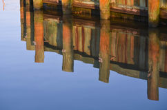 Wall Reflections in the Water. Post and wall reflections with the water in Palacios, Texas stock image