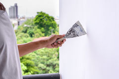 Wall refurbishment with plastering using putty knife Royalty Free Stock Photography