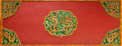 A wall relief with dragons in the Forbidden City, the former palace of the Chinese Emperor. Beijing stock image