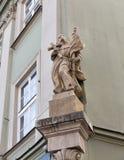 Wall religious sculpture closeup in Krakow, Poland. Stock Image