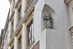 Wall religious sculpture closeup in Warsaw, Poland. Stock Images