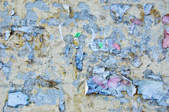 Wall with remnants of paper. Old wall with remnants of paper attached to it Royalty Free Stock Photos