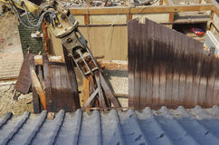 Wall removed by the shears. A Japanese house which is being broken by the shears of the backhoe Stock Image