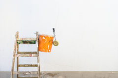 Ladder and painting accessories in front of an empty exterior house wall. Stock Images