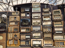 Wall of retro radio sets in the street. Royalty Free Stock Photo