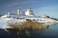 Wall of the riverside priory in Russia. Wall of the priory from white riverside brick in Russia in winter Stock Photography