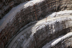 Wall and road in a modern diamond mine. Detail of mining industry Royalty Free Stock Images