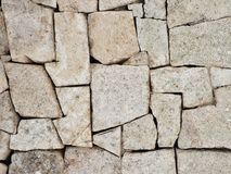 Wall rock. Brick modern rock wall and background Stock Images