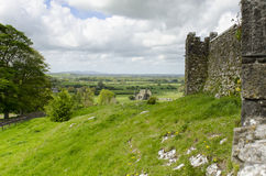 Wall of the Rock of Cashel. A pastoral landscape of ruins and farm lands surrounding the Rock of Cashel in County Tipperary Ireland Royalty Free Stock Photography
