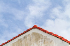 Wall, roof and sky background. Royalty Free Stock Image