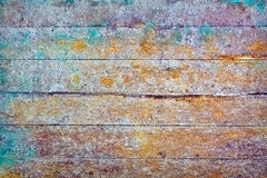Wall - rotten boards with colored stains Stock Image