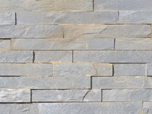 Wall from a rough gray natural stone Stock Photos