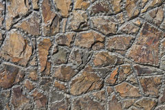 Wall of rough-hewn stones. Background wall of rough-hewn stones closeup Stock Photography