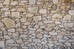A wall of rough untreated wild stone Royalty Free Stock Images