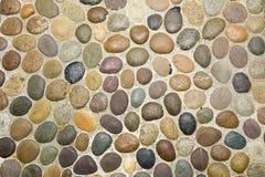 Wall round stone rock texture background Stock Photo