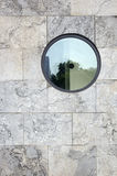 Wall with round window Stock Photo