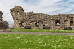 Wall and ruin of medieval castle in St Andrews, Scotland stock photo