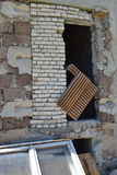 Wall of ruined industrial building and old derelict furniture - detail Stock Photography