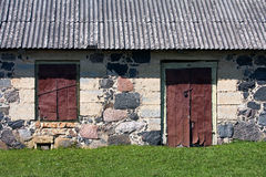Wall of the rural house with door and window Royalty Free Stock Photo
