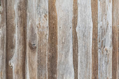 Wall of the rural house made from teak wooden logs Seamless ol wood background Royalty Free Stock Image