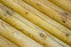 Wall of the rural house from wooden logs. Diagonal Stock Images