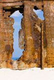 Wall of rust, closeup of a ship wreck at sandy beach, Zakynthos, Greece. royalty free stock images