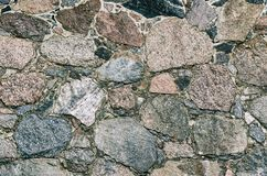 WALL. Rustic wall made of field boulders Stock Image