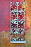 Wall with rusty metal decoration Royalty Free Stock Photo