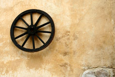 Wall's wheel. Old wheel on the wall Royalty Free Stock Image