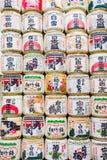 Wall of Sake Barrels. A wall of sake barrels used as decor outside a shrine in Japan Stock Photos