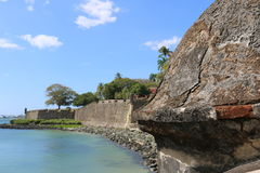 Wall of San Juan, Puerto Rico. The Wall of San Juan, started in 1634, stretches along the shore of the bay. The bastion shown is located right in front of the Royalty Free Stock Images