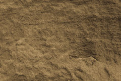 A wall of sand antique colored. A colored antique wall of sand, background Stock Photo