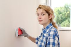 Wall sanding Stock Images