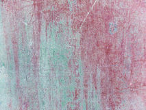 Wall with scratched paint in red and green to use as background Royalty Free Stock Images