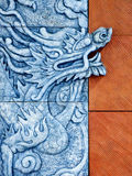 Wall sculpture. A dragon sculpture on the wall Royalty Free Stock Images