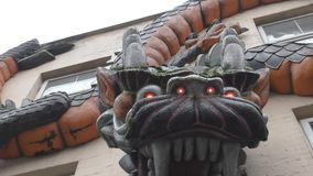 Wall sculpture of a dragon. stock video