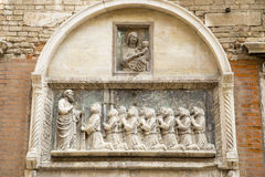 Wall sculpture on an Italian school wall in Venice Stock Image