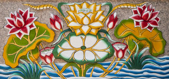 Wall sculpture of a lotus. Stock Photo